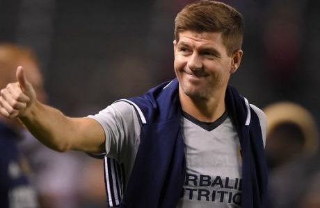 FILE - In this Feb. 9, 2016, file photo, Los Angeles Galaxy midfielder Steven Gerrard, of England, gestures to fans after a soccer match against Club Tijuana, in Carson, Calif. Gerrard is leaving the LA Galaxy after two seasons, and the former England midfielder is still considering what to do next. (AP Photo/Mark J. Terrill, File)