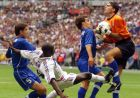 Lilian Thuram of France, center, kicks Italian goalkeeper Gianluca Pagliuca, right, as Italy's Alessandro Costacurta, left, and Fabio Cannavaro attempt to shield him during the soccer World Cup 98 quarter final match between France and Italy at the Stade de France in Saint Denis, north of Paris, Friday July 3, 1998. (AP Photo/Michel Euler)