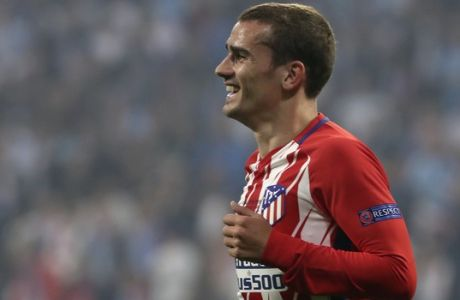 Atletico's Antoine Griezmann celebrates after scoring his side opening goal during the Europa League Final soccer match between Marseille and Atletico Madrid at the Stade de Lyon in Decines, outside Lyon, France, Wednesday, May 16, 2018. (AP Photo/Thibault Camus)