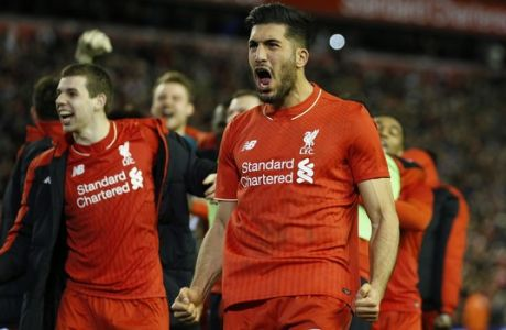 Liverpool's Emre Can, right, and Jon Flanagan, left, celebrate after winning the English League Cup semifinal second leg soccer match between Liverpool and Stoke City at Anfield stadium in Liverpool, England, Tuesday, Jan. 26, 2016. (AP Photo/Jon Super)