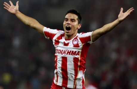 Javier Saviola  celebrates his first goal with Olympiakos, against Atromitos  during a Greek league soccer match at the Karaiskaki stadium in the port of Piraeus, near Athens, Sunday, Aug. 25, 2013. Javier Saviola scored the winner with a header in the 54th minute to give Olympiakos a 2-1 victory over visiting Atromitos in the Greek league. (AP Photo/Kostas Tsironis)
