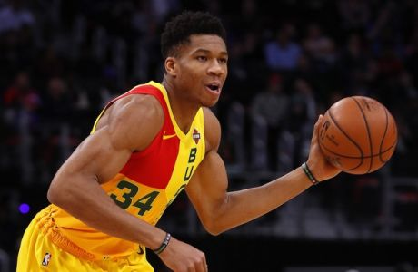 Milwaukee Bucks forward Giannis Antetokounmpo plays against the Detroit Pistons in the first half of an NBA basketball game in Detroit, Monday, Dec. 17, 2018. (AP Photo/Paul Sancya)