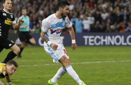 Marseille's Remy Cabella, right, during the League One soccer match between Marseille and Angers, at the Velodrome Stadium, Friday, March 10, 2017. (AP Photo/Claude Paris)