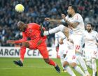 Caen's midfielder Baissama Sankoh, left, challenges for the ball with Marseille's Konstantinos Mitroglou during the League One soccer match between Marseille and Caen, at the Velodrome stadium, in Marseille, southern France, Sunday, Nov. 5, 2017. (AP Photo/Claude Paris)