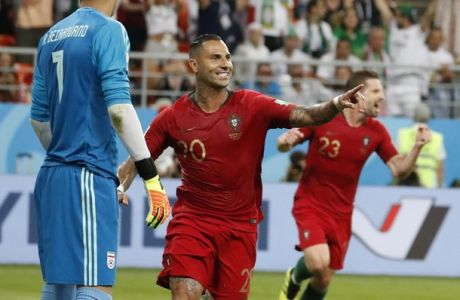 Portugal's Ricardo Quaresma, second left, celebrates scoring his team's opening goal along with teammate Portugal's Andre Silva during the group B match between Iran and Portugal at the 2018 soccer World Cup at the Mordovia Arena in Saransk, Russia, Monday, June 25, 2018. (AP Photo/Pavel Golovkin)