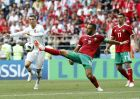 Portugal's Cristiano Ronaldo, left, is challenged by Morocco's Mehdi Benatia during the group B match between Portugal and Morocco at the 2018 soccer World Cup at the Luzhniki Stadium in Moscow, Russia, Wednesday, June 20, 2018. (AP Photo/Antonio Calanni)