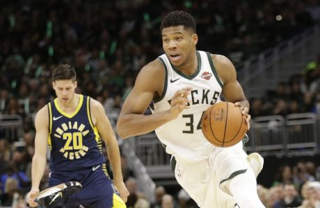 Indiana Pacers guard Tyreke Evans goes down on the court trying to defend Milwaukee Bucks forward Giannis Antetokounmpo during the second half of an NBA basketball game Friday, Oct. 19, 2018, in Milwaukee. Milwaukee won 118-101. (AP Photo/Mike Roemer)