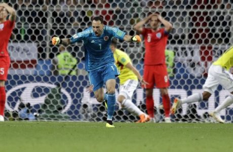 Colombia goalkeeper David Ospina celebrates after his side's first goal during the round of 16 match between Colombia and England at the 2018 soccer World Cup in the Spartak Stadium, in Moscow, Russia, Tuesday, July 3, 2018. (AP Photo/Matthias Schrader)