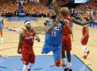 Oklahoma City Thunder forward Paul George (13) loses the ball as he drives between Portland Trail Blazers forward Maurice Harkless (4) and forward Al-Farouq Aminu during the second half of Game 3 of an NBA basketball first-round playoff series Friday, April 19, 2019, in Oklahoma City. (AP Photo/Sue Ogrocki)