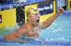 Cesar Cielo, of Brazil, celebrates after winning the men's 50-meter butterfly final at the Pan Pacific Swimming Championships, Wednesday, Aug. 18, 2010, in Irvine, Calif.  (AP Photo/Mark J. Terrill)