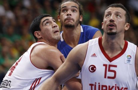Hidayet Turkoglu, right, and Enes Kanter, left, of Turkey is challenged by Joakim Noah, from France during the EuroBasket 2011, European Basketball Championships group E match between Turkey and France in Vilnius, Lithuania, on Wednesday, Sept. 7, 2011. (AP Photo/Mindaugas Kulbis)