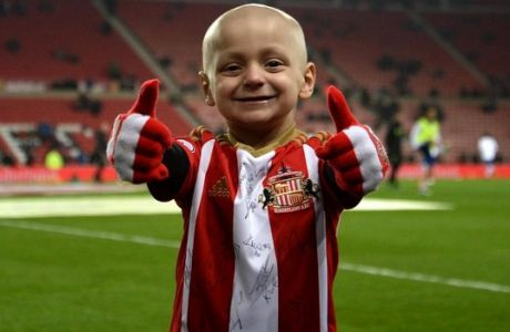 "Bradley Lowery, aged five, who is terminally ill with cancer, stands on the pitch before the Premier League match at the Stadium of Light, Sunderland. PRESS ASSOCIATION Photo. Picture date: Wednesday December 14, 2016. See PA story SOCCER Sunderland. Photo credit should read: Anna Gowthorpe/PA Wire. RESTRICTIONS: EDITORIAL USE ONLY No use with unauthorised audio, video, data, fixture lists, club/league logos or ""live"" services. Online in-match use limited to 75 images, no video emulation. No use in betting, games or single club/league/player publications."