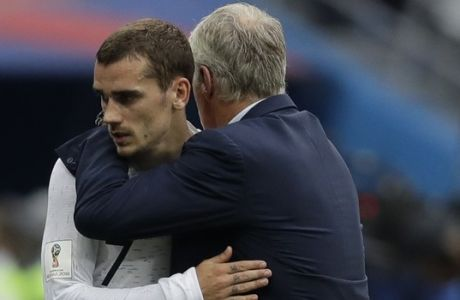 France head coach Didier Deschamps embraces player Antoine Griezmann as he leaves the pitch during their quarterfinal match against Uruguay the 2018 soccer World Cup in the Nizhny Novgorod Stadium, in Nizhny Novgorod, Russia, Friday, July 6, 2018. (AP Photo/Natacha Pisarenko)