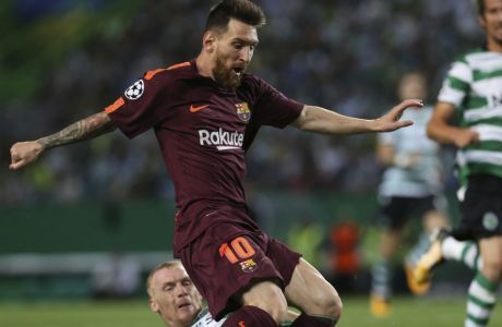 Barcelona's Lionel Messi, top, is challenged by Sporting's Jeremy Mathieu, during a Champions League, Group D soccer match between Sporting CP and FC Barcelona at the Alvalade stadium in Lisbon, Wednesday Sept. 27, 2017. (AP Photo/Armando Franca)