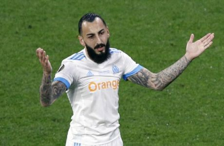 Marseille's Konstantinos Mitroglou reacts after missing a chance to score during the Europa League Final soccer match between Marseille and Atletico Madrid at the Stade de Lyon outside Lyon, France, Wednesday, May 16, 2018. (AP Photo/Christophe Ena)