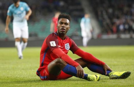 England's Daniel Sturridge sits on the pitch during the World Cup Group F qualifying soccer match between Slovenia and England, at Stozice stadium in Ljubljana, Slovenia, Tuesday, Oct. 11, 2016. (AP Photo/Darko Bandic)
