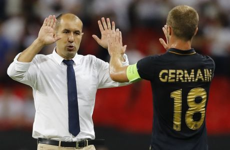 Monaco's head coach Leonardo Jardim, left, celebrates with Monaco's Valere Germain after the Champions League Group E soccer match between Tottenham Hotspur and Monaco at Wembley stadium in London Wednesday, Sept. 14, 2016. (AP Photo/Frank Augstein)