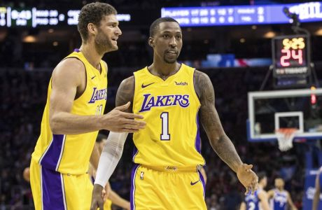 Los Angeles Lakers Kentavious Caldwell-Pope, right, reacts with Brook Lopez, left, during the second half of an NBA basketball game, Thursday, Dec. 7, 2017, in Philadelphia. The Lakers won 107-104. (AP Photo/Chris Szagola)