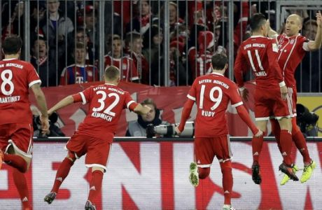 Bayern's Arjen Robben, right, and Bayern's James celebrate after scoring the opening goal during the German Soccer Bundesliga match between FC Bayern Munich and RB Leipzig in Munich, Germany, Saturday, Oct. 28, 2017. (AP Photo/Matthias Schrader)