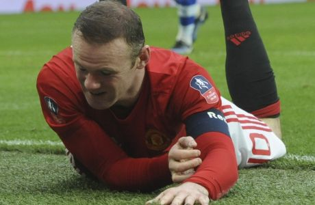 Manchester United's Wayne Rooney lies on the ground after missing a chance to score a goal during the English FA Cup Third Round match between Manchester United and Reading at Old Trafford in Manchester, England, Saturday, Jan. 7, 2017. (AP Photo/Rui Vieira)