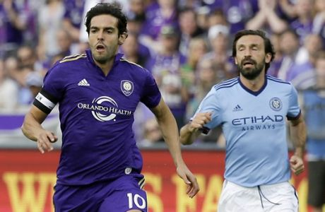 Orlando City's Kaka (10) moves the ball past New York City FC's Andrea Pirlo during the first half of an MLS soccer game, Sunday, March 5, 2017, in Orlando, Fla. (AP Photo/John Raoux)