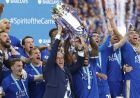 Leicesters team manager Claudio Ranieri and Leicesters Wes Morgan lift the trophy as Leicester City celebrate becoming the English Premier League soccer champions at King Power stadium in Leicester, England, Saturday, May 7, 2016.(AP Photo/Matt Dunham)