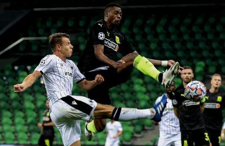 Κάιο και Σβαμπ μάχονται για την μπάλα στην αναμέτρηση της Κράσνονταρ με τον ΠΑΟΚ (1-1) στη Ρωσία, την πρώτη των δύο ομάδων στα playoffs του Champions League 2020-2021. (ΦΩΤΟΓΡΑΦΙΑ: ΠΑΕ ΠΑΟΚ / ΝΙΚΟΣ ΒΕΡΒΕΡΙΔΗΣ)