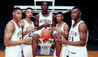 FILE - In this November 1991, file photo, Michigan's Fab Five from left, Jimmy King, Juwan Howard, Chris Webber, Jalen Rose and Ray Jackson pose in Ann Arbor, Mich. In a wide-ranging recruiting scandal that resulted in most of their records being wiped out of the books, Webber, booster Ed Martin and the rest afforded college hoops a preview of the havoc that the growing influence of cash, with boosters, shoe companies and club coaches all playing a role in its distribution. (AP Photo/File)