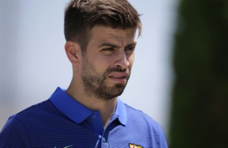 FC Barcelona's Gerard Pique arrives for a press conference at the Sports Center FC Barcelona Joan Gamper in Sant Joan Despi, Spain, Friday, May 26, 2017. FC Barcelona will play against Alaves in the Spanish Copa del Rey soccer final on Saturday. (AP Photo/Manu Fernandez)