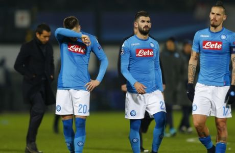 Napoli's players leave the pitch at the end of a Champions League Group F soccer match between Feyenoord and Napoli at the Kuip stadium in Rotterdam, Netherlands, Wednesday, Dec. 6, 2017. Feyenoord defeated Napoli 2-1. (AP Photo/Peter Dejong)