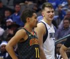 Atlanta Hawks guard Trae Young (11) and Dallas Mavericks forward Luka Doncic (77) stand on the court during the second half of an NBA basketball game Wednesday, Dec. 12, 2018, in Dallas. (AP Photo/Richard W. Rodriguez)