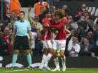 Manchester United's Marouane Fellaini, right, celebrates with teammates after scoring the opening goal of the game during the Europa League semifinal second leg soccer match between Manchester United and Celta Vigo at Old Trafford in Manchester, England, Thursday, May 11, 2017. (AP Photo/Dave Thompson)
