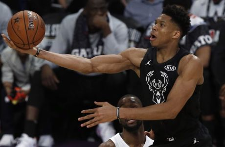 Team Stephen's forward Giannis Antetokounmpo, right, of the Milwaukee Bucks throws up a shot between Team LeBron's forward LeBron James, left, of the Cleveland Cavaliers and forward Paul George, bottom center, of the Oklahoma City Thunder during the second half of an NBA All-Star basketball game, Sunday, Feb. 18, 2018, in Los Angeles. (AP Photo/Alex Gallardo)