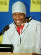 Allen Iverson of the Philadelphia 76ers, smiles proudly after winning the NBA Rookie of the Year Award Thursday, May 1, 1997, during a news conference in Philadelphia.  Iverson received 44 of 115 votes from sports writers and broadcasters who cover the NBA. (AP Photo/Dan Loh)