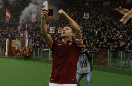 Roma's Francesco Totti celebrates after scoring during a Serie A soccer match between Roma and Lazio at Rome's Olympic stadium, Sunday, Jan. 11, 2015. (AP Photo/Gregorio Borgia)