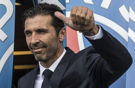 PSG's new signing goalkeeper Gianluigi Buffon gives a thumbs up as he poses for photographers during his official presentation at the Parc des Princes stadium in Paris, France, Monday, July 9, 2018. Free agent Gianluigi Buffon signed for Paris Saint-Germain last Friday. The veteran goalkeeper penned a one-year deal at the French champion with the option for an additional season. (AP Photo/Jean-Francois Badias)