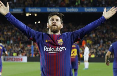 Barcelona's Lionel Messi celebrates scoring his side's second goal during a Spanish La Liga soccer match between Barcelona and Real Madrid, dubbed 'El Clasico', at the Camp Nou stadium in Barcelona, Spain, Sunday, May 6, 2018. (AP Photo/Emilio Morenatti)