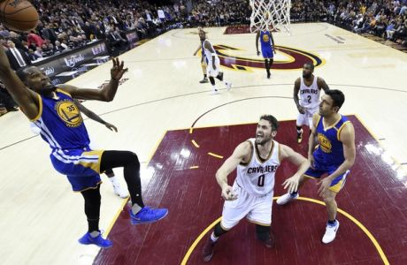 Golden State Warriors forward Kevin Durant (35) drives to the basket over Cleveland Cavaliers forward Kevin Love (0) during the second half of Game 3 of basketball's NBA Finals in Cleveland, Wednesday, June 7, 2017. Golden State won 118-113. (Kyle Terada/Pool Photo via AP)