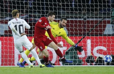 PSG forward Neymar, left, scores his side's second goal past Liverpool goalkeeper Alisson during a Champions League Group C soccer match between Paris Saint Germain and Liverpool at the Parc des Princes stadium in Paris, Wednesday, Nov. 28, 2018. (AP Photo/Francois Mori)
