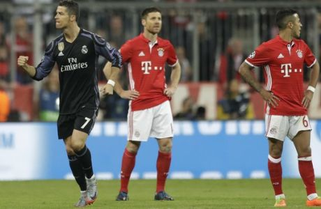 Real Madrid's Cristiano Ronaldo celebrates scoring his side's first goal during the Champions League quarterfinal first leg soccer match between FC Bayern Munich and Real Madrid, in Munich, Germany, Wednesday, April 12, 2017. (AP Photo/Matthias Schrader)