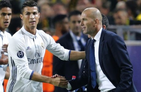 Real Madrid's Cristiano Ronaldo celebrates scoring the opening goal with Real Madrid's head coach Zinedine Zidane during the Champions League group F soccer match between Borussia Dortmund and Real Madrid in Dortmund, Germany, Tuesday, Sept. 27, 2016. (AP Photo/Michael Probst)