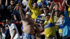 Boca Juniors' fans cheer before the game against Argentinos Juniors during an Argentina's league soccer match in Buenos Aires, Argentina, Sunday, Sept. 9, 2012. (AP Photo/Eduardo Di Baia)
