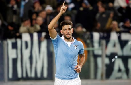 Lazios Filip Djordjevic celebrates after scoring during a Serie A soccer match between Lazio and Sampdoria at Rome's Olympic Stadium, Monday, Jan. 5, 2015. (AP Photo/Andrew Medichini)