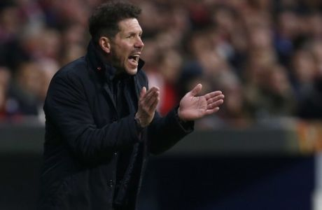 Atletico Madrid head coach Diego Simeone reacts during an Europa League round of 32 second leg soccer match between Atletico Madrid and Copenhagen at the Metropolitano stadium in Madrid, Thursday, Feb. 22, 2018. (AP Photo/Francisco Seco)