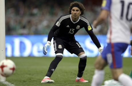 Mexico's goalkeeper Guillermo Ochoa eyes the ball during a World Cup soccer qualifying match between Mexico and the U.S. at Azteca Stadium in Mexico City, Sunday, June 11, 2017.(AP Photo/Rebecca Blackwell)