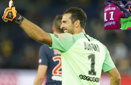 PSG's goalkeeper Gianluigi Buffon gives the thumb-up sign during their League One soccer match between Paris Saint-Germain and Caen at Parc des Princes stadium in Paris, Sunday, Aug. 12, 2018. (AP Photo/Michel Euler)