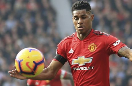 FILE - In this file photo dated Sunday, Feb. 24, 2019, Manchester United's Marcus Rashford, in action against Liverpool during the English Premier League soccer match at Old Trafford stadium in Manchester, England.  21-year old Rashford has signed a new four-year contract at Manchester United, the English Premier League club have announced Monday July 1, 2019. (AP Photo/Jon Super, FILE)