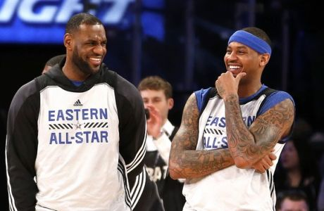 CORRECTS DATE  - East Team's LeBron James, left, of the Cleveland Cavaliers, and Carmelo Anthony, of the New York Knicks, talk during practice at the NBA All-Star basketball game, Saturday, Feb. 14, 2015, in New York. (AP Photo/Julio Cortez)