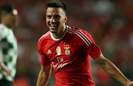 Benfica's Samaris, celebrates after scoring his team's second goal against Moreirense during a Portuguese league soccer match at Benfica's Luz stadium in Lisbon, Saturday, Aug. 29, 2015. (AP Photo/Steven Governo)
