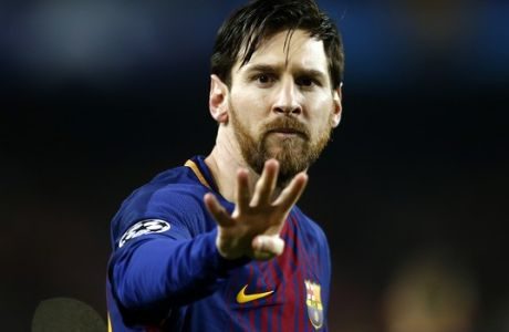 Barcelona's Lionel Messi gestures after scoring the opening goal during the Champions League round of sixteen second leg soccer match between FC Barcelona and Chelsea at the Camp Nou stadium in Barcelona, Spain, Wednesday, March 14, 2018. (AP Photo/Manu Fernandez)